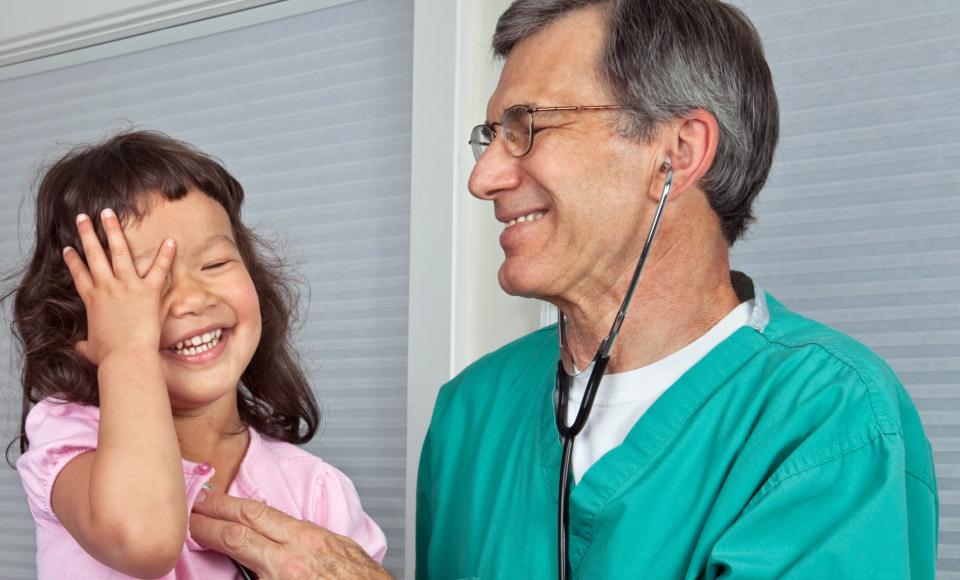 Pediatrician checking the baby