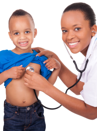 Doctor checking a young boy
