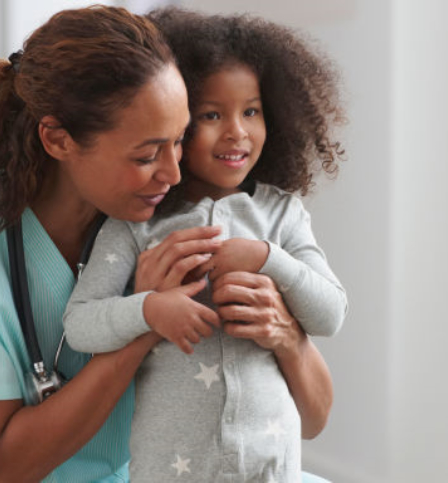 Nurse hugging a child