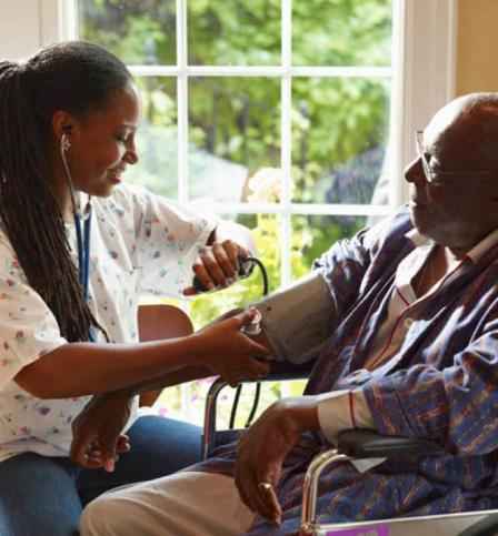 Nurse checking the blood pressure of a senior