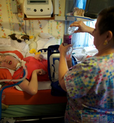 Nurse preparing a medication for a child