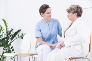 Nurse talking to a senior